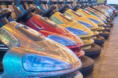 Bumper coloured cars. Bumper cars in a row royalty free stock image