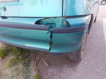 Bumper damaged rear green car. Bumper damaged crashed  rear green car Royalty Free Stock Photography