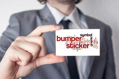 Bumper sticker. Businessman in suit with a black tie showing or Stock Photo