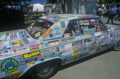 A bumper sticker encrusted car at the Orange County fair grounds Stock Image