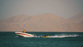 Bumper Tube Ride behind the Boat on Red Sea. Slow Motion stock video