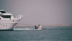 Bumper Tube Ride behind the Boat on Red Sea. Slow Motion stock footage