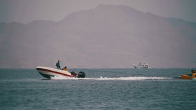 Bumper Tube Ride behind the Boat on Red Sea. Slow Motion. EGYPT, SOUTH SINAI, SHARM EL SHEIKH, NOVEMBER 29, 2016: Bumper Tube Ride behind the Boat on Red Sea in stock footage