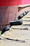 Bumper tyres on a pier Royalty Free Stock Image