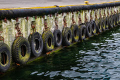 Bumpers with tire. Old tires used as fenders Royalty Free Stock Photos
