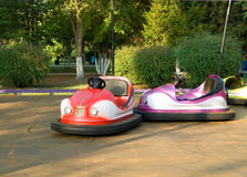 Bumping Cars. Bumper car ride with different color bumper cars, taken outdoors Stock Image