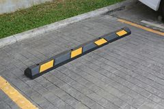 Bumps barrier for reduce car speed when parking.  stock photos