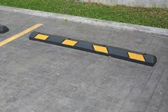 Bumps barrier for reduce car speed when parking.  stock photography