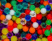 Bumpy Beads, Textures and Colors. Background close up of multicolored water beads with bumpy textured surfaces royalty free stock photo