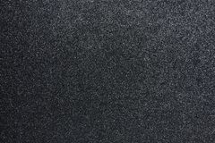 Bumpy black glitter textured background, Closeup. Bumpy black glitter textured abstract background for presentation backdrop, wallpaper, Closeup royalty free stock images