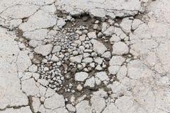 Bumpy concrete road. Bumpy damaged concrete road, destroyed parking lot surface Stock Photography