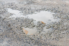 Bumpy concrete road. Bumpy damaged concrete road, destroyed parking lot surface Royalty Free Stock Photos
