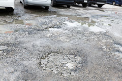 Bumpy concrete road. Bumpy damaged concrete road, destroyed parking lot surface Royalty Free Stock Photo