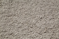 Bumpy concrete texture. Closeup to a bumpy concrete gray texture. There is space for text Royalty Free Stock Photos