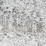 Bumpy concrete wall fragment. Bumpy old concrete wall fragment as a grunge background texture royalty free stock images