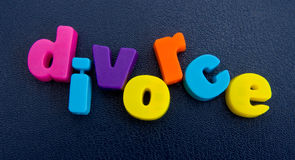 A bumpy divorce. A concept image of a divorce which does not run smoothly using colorful letters making up the word ' divorce ' set upon a plain dark background Royalty Free Stock Images
