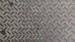 Bumpy metal texture. Rusty metal texture grated floor, handheld top down overhead view stock footage