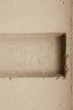 Bumpy relief of a concrete wall beige color Royalty Free Stock Images