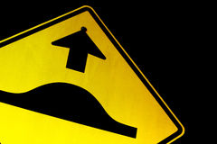 Bumpy Road Ahead. Speed bump road sign in bright yellow and black Stock Photo