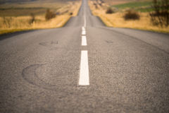 Bumpy road ahead. Shallow depth of field image of an Icelandic road Royalty Free Stock Photos