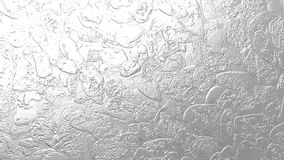 Bumpy silver texture for festive and elegant designs. Grungy silver texture for festive and elegant designs. background, backdrop, wallpaper, cards, surfaces Royalty Free Stock Image