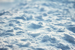 Bumpy surface of cracked ice crust. Hight contrast texture light and shadows on snow field. Stock Photography