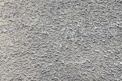 Bumpy texture cement wall of dirty gray color Royalty Free Stock Photo