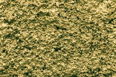 Bumpy wall surfaces of golden color Stock Image