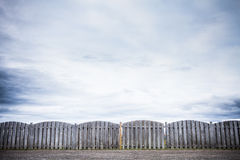 Bumpy Wooden Fence pattern. And Cloudy Autumn Sky stock image