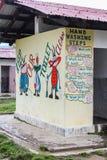 Bumthang Bhutan - September 14, 2016: Illustrationer på toalettväggen i Wangdicholing fäller ned högstadiet på Bumthang, Bhutan Royaltyfria Bilder