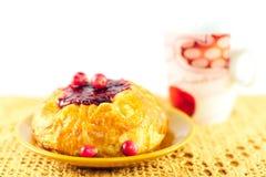 Bun and berries Stock Image