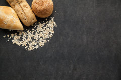 Bun of bread with oat flakes. Royalty Free Stock Photo