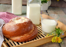Bun with butter and milk. Breakfast in rustic style. Selective f. Bun with butter and milk. Breakfast in rustic style Stock Image