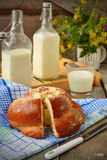 Bun with butter and milk. Breakfast in rustic style. Selective f. Ocus Royalty Free Stock Image