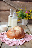 Bun with butter and milk. Breakfast in rustic style. Selective f. Ocus Royalty Free Stock Images