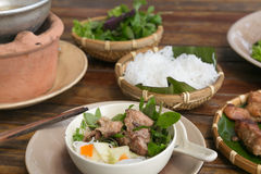 Bun Cha serving in Vietnam. Closeup to a serving of Bun Cha in Vietnam. The meal is a popular dish in the country and consists of grilled pork, rice noodles royalty free stock photos