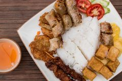 Bun Cha, traditional vietnamese food. Spring rolls with tofu, rice, pork steak, salad and pineapple. Bun Cha, traditional vietnamese food. Spring rolls with tofu royalty free stock photos