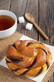 Bun with chocolate and cup of tea Royalty Free Stock Photo