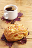 Bun, coffee and autumn leaves Royalty Free Stock Photography