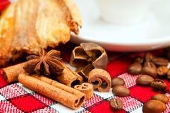 Bun, coffee and cinnamon Royalty Free Stock Photo