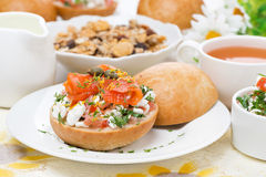 Bun with cottage cheese, herbs, tomato and salmon for breakfast Stock Photo