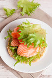 Bun with cottage cheese, herbs, tomato and salmon, vertical Stock Images