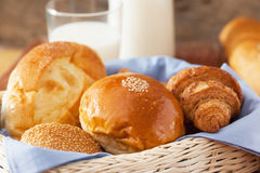 Bun ,Croissant and bread in basket stock images