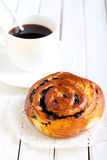 Bun and cup of coffee Royalty Free Stock Photo