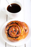 Bun and cup of coffee Royalty Free Stock Images
