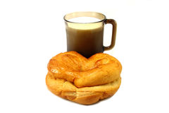 Bun with cup of milk Royalty Free Stock Photography