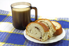 Bun with cup of milk Royalty Free Stock Image