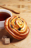 Bun with cup of tea Royalty Free Stock Image