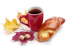 Bun and cup of tea Royalty Free Stock Photos
