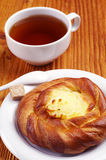Bun with custard and tea Stock Photos
